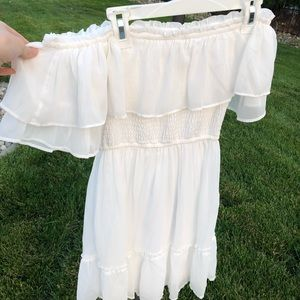 Flowing white off the shoulder dress